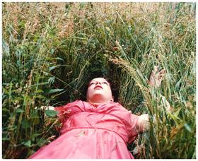 Lying_in_field_in_red_dress_2